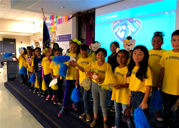 harvest valley elementary students celebrating college kickoff 2019