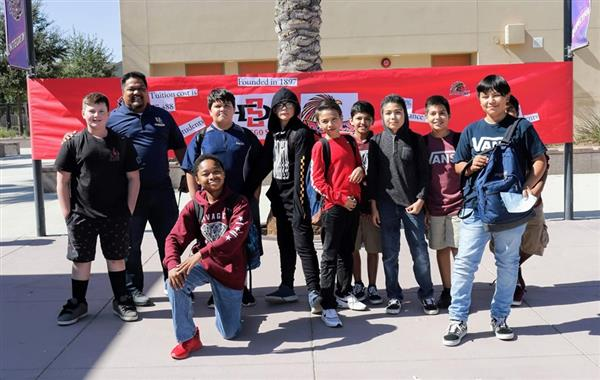 Middle school students celebrating college kickoff with Principal Hernandez